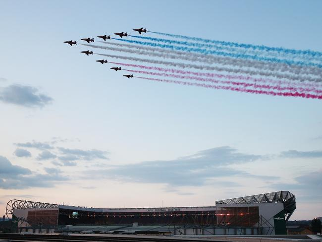 The RAF Red Arrows fly over Celtic Park.