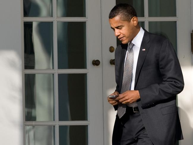 Barack Obama uses his BlackBerry in this Janiuary 2009 file picture.