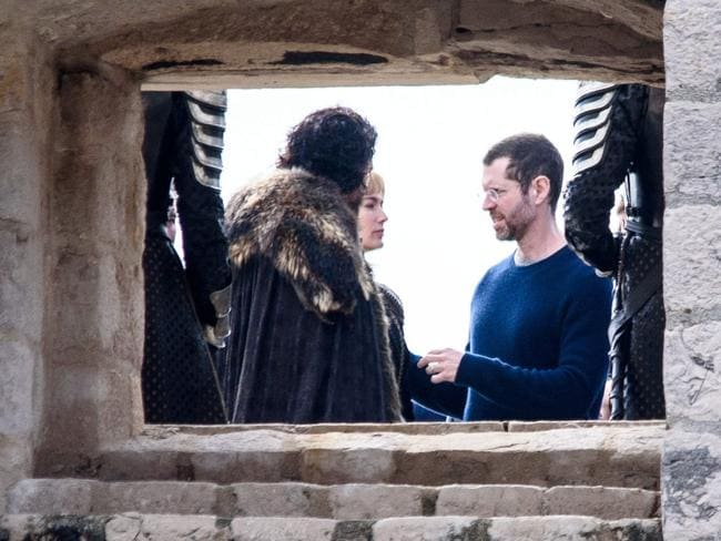 Weiss speaking to Game of Thrones stars Kit Harington and Lena Headey during filming for season eight. Picture: Cropix / Splash News