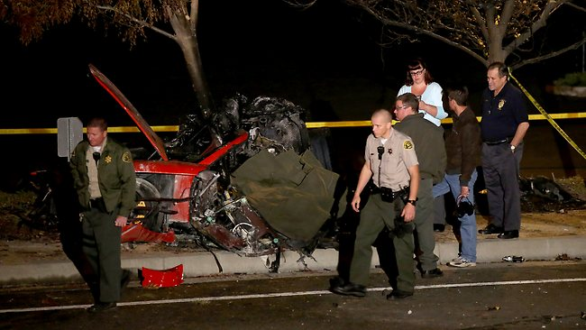 "UK CLIENTS MUST CREDIT: AKM-GSI ONLY  <br />**WARNING GRAPHIC IMAGERY**UK CLIENTS MUST CREDIT: AKM-GSIA coroner and emergency services attend the car accident site where actor Paul Walker was tragically killed in Santa Clarita, CA. Paul Walker, who just turned 40 in September, passed away today in a tragic car accident while attending a charity event for his organization Reach Out Worldwide. The actor's rep confirmed his death and stated that Paul, ""was a passenger in a friend's car, in which both lost their lives"". The coroner arrived this evening to examine the victims and a tarp was put up to block any onlookers' view.  <p>Pictured: The scene of Paul Walker's car accident in Santa Clarita, CA</p>  <p><b>Ref: SPL659560 011213 </b><br />Picture by: AKM-GSI / Splash News<br /></p>  <p><b>Splash News and Pictures</b><br />Los Angeles: 310-821-2666<br />New York: 212-619-2666<br />London: 870-934-2666<br />photodesk@splashnews.com<br /></p>"