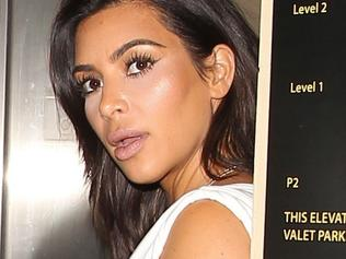 Kim Kardashian gets by with a little help from her butt pads