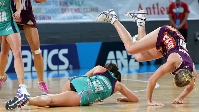 Vixens' WA Madi Robinson (L) collides with Firebirds' WD Gabi Simpson to send both sprawling.