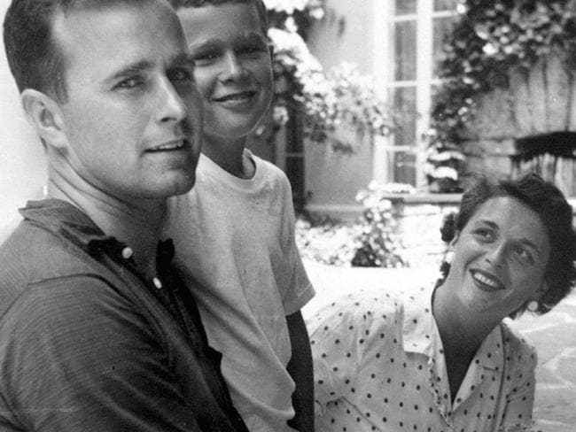 Granddaughter Jenna Bush Hager said Mrs Bush, pictured with her husband and son, was a 'fighter' and an 'enforcer'. Picture: George Bush Presidential Library via AP
