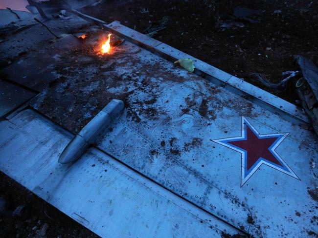 Rebel fighters shot down a Russian plane over Syria's northwest Idlib province. Picture: AFP/Omar Haj Kadour