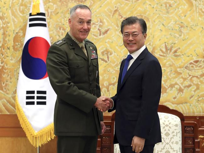 South Korean President Moon Jae-in, right, poses with U.S. Joint Chiefs Chairman Gen. Joseph Dunford for a photo during a meeting at the presidential Blue House in Seoul, South Korea. Picture: AP.