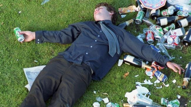 A drunken racegoer passed out amongst rubbish.