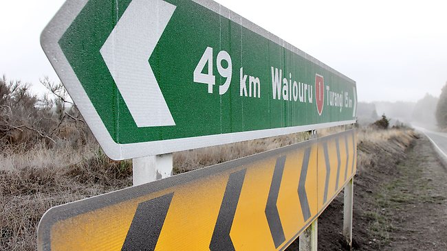 Road signs and the surrounding area are coated in ash on state highway one after Mt Tongariro erupted. Picture: Hagen Hopkins