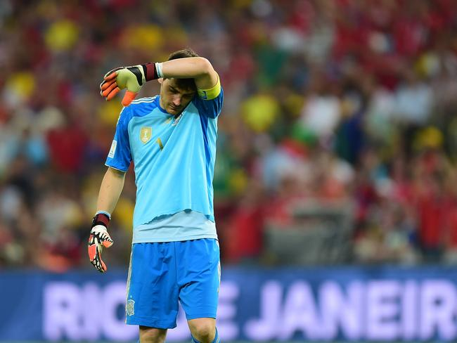 Spanish goalkeeper Iker Casillas is downcast after his two disastrous performances in two defeats.