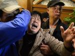 A relative of passengers on Malaysia Airlines flight MH370 cries after hearing the news that the plane plunged into Indian Ocean at a hotel in Beijing on March 24, 2014. Picture: AFP PHOTO / GOH CHAI HIN