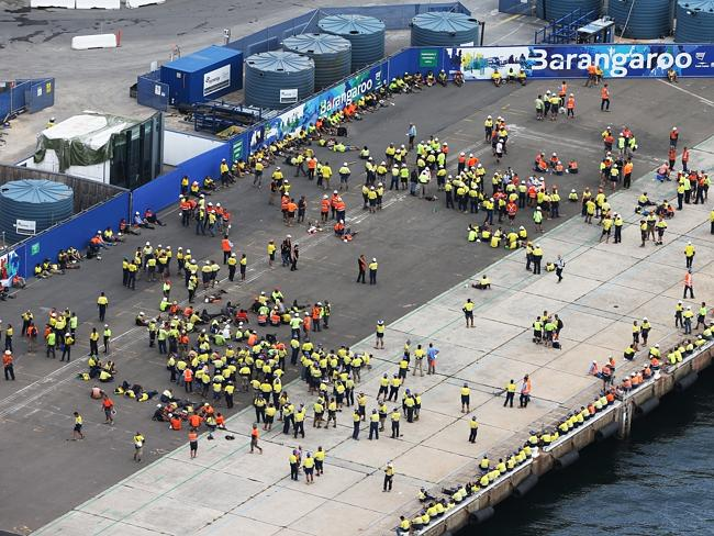 Barangaroo workers rally for roll-call to ensure no one has been left behind. Picture: Toby Zerna