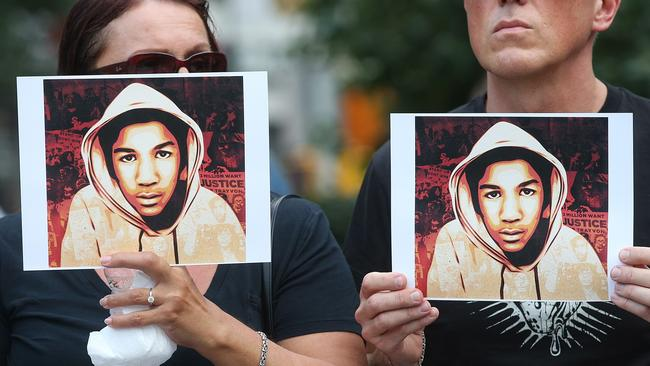 Fighting injustice ... protesters hold portraits of Trayvon Martin at a 2013 rally in Manhattan. Picture: Mario Tama/Getty Images/AFP