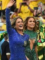 Singers Claudia Leitte (L) and Jennifer Lopez walk off after performing during the Opening Ceremony of the 2014 FIFA World Cup Brazil prior to the Group A match between Brazil and Croatia at Arena de Sao Paulo on June 12, 2014 in Sao Paulo, Brazil. (Photo by Buda Mendes/Getty Images)