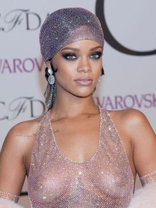 Pierced nipples are made for showing off, righ Ri-ri? Photo: Lars Niki/Corbis via Getty Images