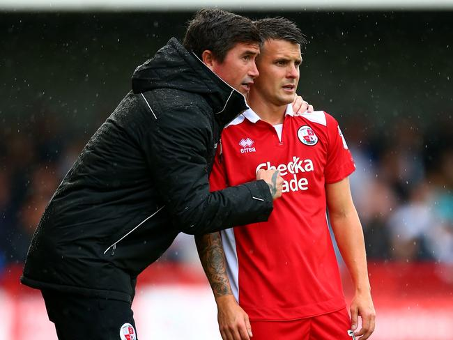Harry Kewell gives instructions to Crawley Town player Dean Cox.
