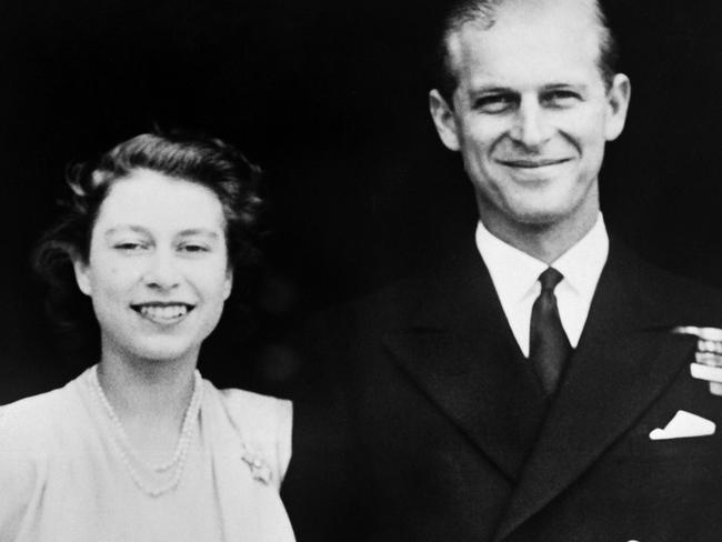 (FILES) This file photo taken on July 11, 1947 shows Princess Elizabeth (future Queen Elizabeth II) and Philip of Greece (future Duke of Edinburgh) posing on the day of their engagement, in July 1947 , outside Buckingham Palace in London. Queen Elizabeth II and Prince Philip will celebrate their platinum wedding anniversary on November 20, marking 70 years since they married in the splendour of Westminster Abbey. / AFP PHOTO / STR