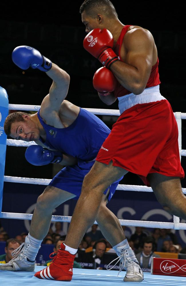 England's Joseph Joyce (red) dominated the gold medal bout against Joe Goodall.