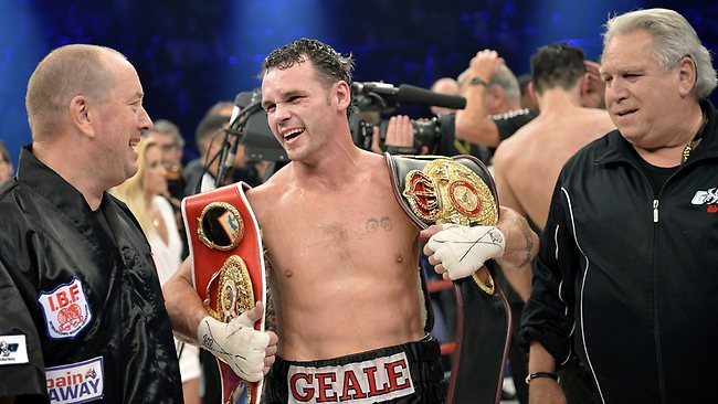 Daniel Geale of Australia celebrates with coach Graham Shaw, left, and manager Gary Shaw, right, after his unification title bout against WBA world boxing champion Felix Sturm in 2012.