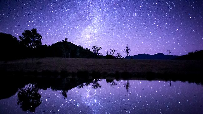 Stars over reflective Lake Moogerah. Picture: Andrew Tallon