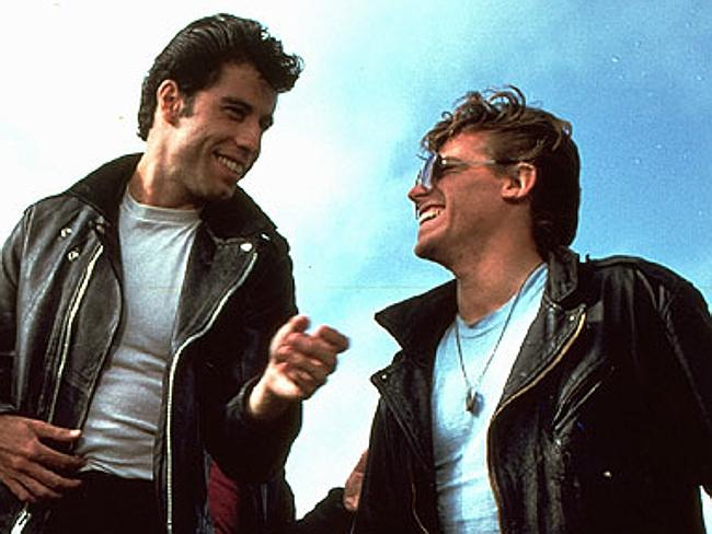 Travolta and Conaway as Danny Zuko and Kenickie, members of the super cool T-Birds.