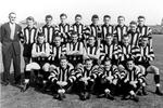 Lou in the centre of a 1955 Collingwood team photo.