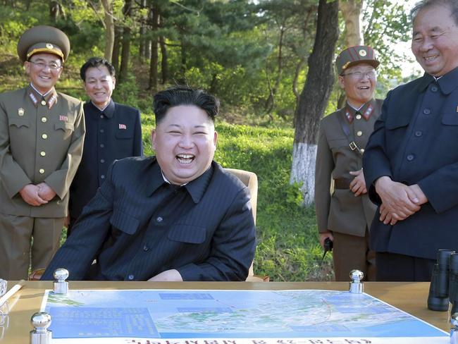 "Kim Jong Un watches the test launch of a solid-fuel ""Pukguksong-2""with his team of scientists. Picture: KCNA/AP"