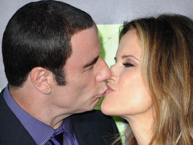Family man ... John Travolta and his wife Kelly Preston. Picture: AFP/Joe Klamar