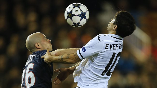 EUROPEAN Champions League, round of 16, first leg: PSG's defender Christophe Jallet (L) vies with Valencia's Argentinian midfielder Ever Banega in Valencia. Picture: Jose Jordan