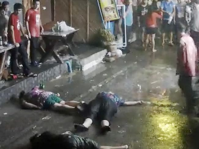 An elderly British couple and their son are on the ground after they were savagely attacked during a family vacation in Hua, Hin, Thailand. Picture: AP.
