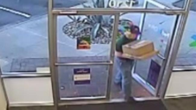 This is one of the first images to emerge of the Austin bombing suspect, who was captured on CCTV while delivering packages to a FedEx distribution centre on Sunday.