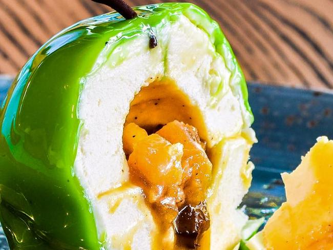 Patissez's Apple Bombe — apple calvados mousse sphere filled with a salted caramelised apple crumble, dipped in white chocolate with a green glaze. Picture: Facebook Patissez