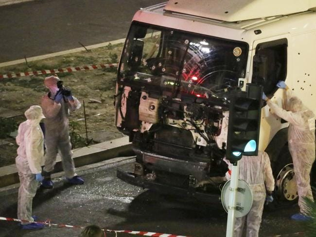 Authorities investigate a truck after it ploughed through Bastille Day revellers in the French resort city of Nice, France, killing 86 people, in July 2016. Picture: AP.