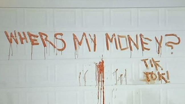 The threat scrawled across the garage door in cat blood at Arundel. Pic: ABC