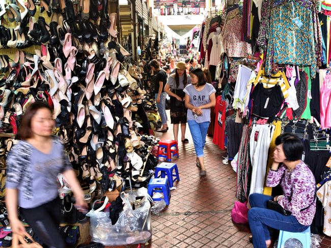 Clever tourists know to skip the crowds in the chaotic Old Quarter and head to Hom Market for their retail fix. Picture: Ronan O'Connell