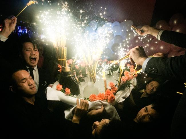 Waiters bring in a bathtub filled with expensive drinks and accompanied by flowers, sparklers and balloons at Bar Rouge. Photo: Marc Ressang