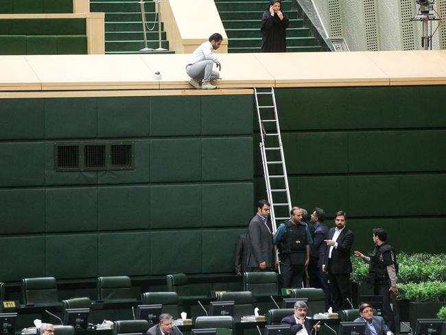 Policemen deploying in the main hall of Iranian parliament to protect politicians during the attack which targeted the complex. Picture: AFP