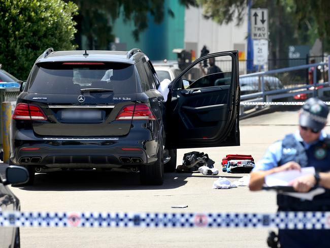 Police at the crime scene where Mick Hawi's Mercedes sits in the gym car park at Rockdale on Thursday. Picture: Toby Zerna