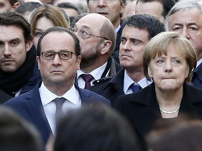 French President Francois Hollande and German Chancellor Angela Merkel march in Paris, France, Picture: AP//Michel Euler.