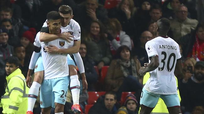West Ham United's Ashley Fletcher, left celebrates.