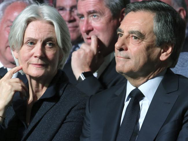 Conservative French presidential candidate Francois Fillon, right, and his wife Penelope. Picture: AP