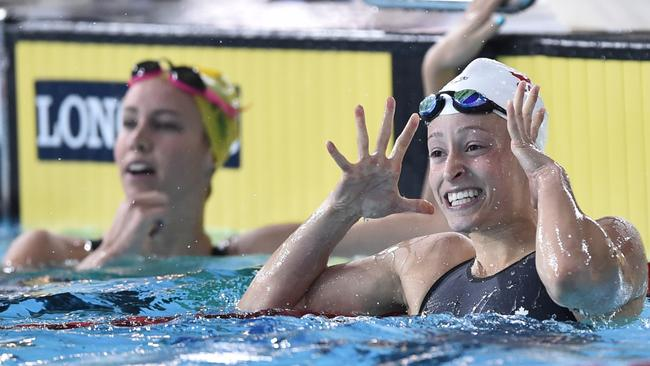 Canada's Katerine Savard (right) celebrates taking gold in the 100m butterfly, while Australia's Emma McKeon (left) finished third.