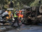 Police at the scene of a horror smash at the bottom of the freeway. Picture: Roger Wyman
