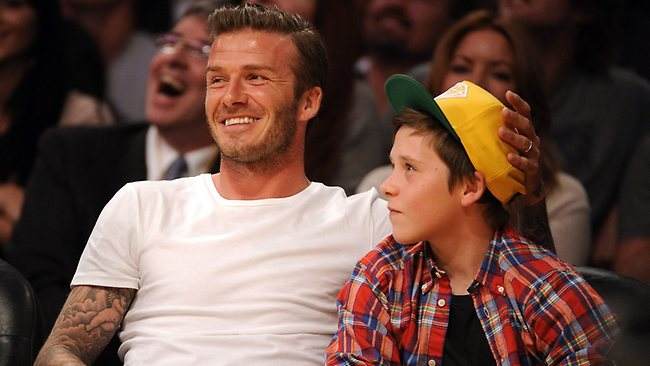 David Beckham and son Brooklyn at a basketball game last year. The 14-year-old has been seen trying out for Chelsea.