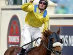 <p>Damien Oliver inspired the racing world with his 2002 Melbourne Cup victory aboard Media Puzzle.</p>