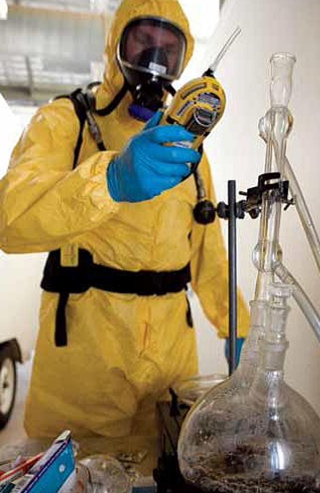 A drug lab is dismantled inside a Queensland home.