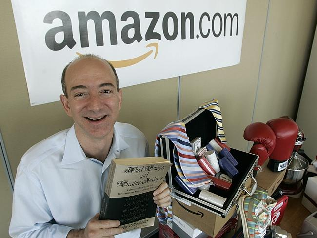 Jeff Bezos with some of the goodies you can with just a click of your mouse.
