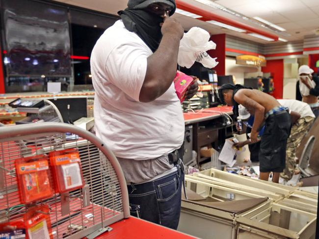 Car windows were smashed and several stores were looted after 18-year-old Michael Brown was shot and killed by a police officer. Pic: AP.