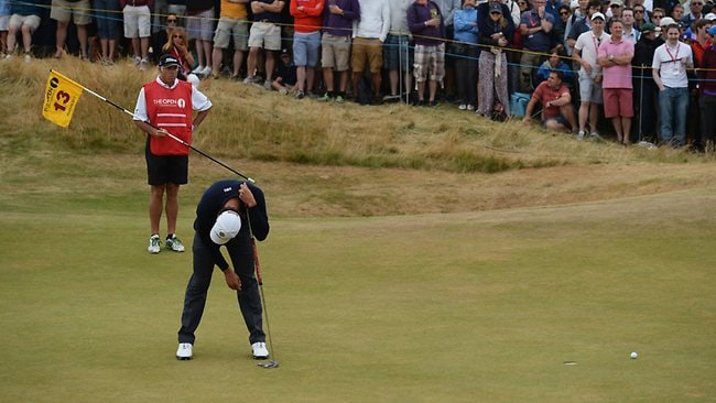 Adam Scott reacts to a missed putt on the 13th green during the final round of the 142nd Open Championship at Muirfield.