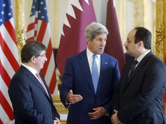 Word games ... Turkish Foreign Minister Ahmet Davutoglu, US Secretary of State John Kerry and Qatari Foreign Minister Khaled al-Attiyah speak after their meeting regarding a ceasefire between Hamas and Israel.