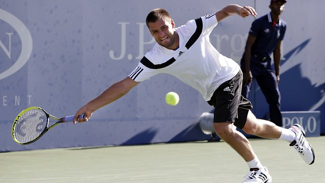 Mikhail Youzhny, of Russia, chases down a shot during his match against Lleyton Hewitt.