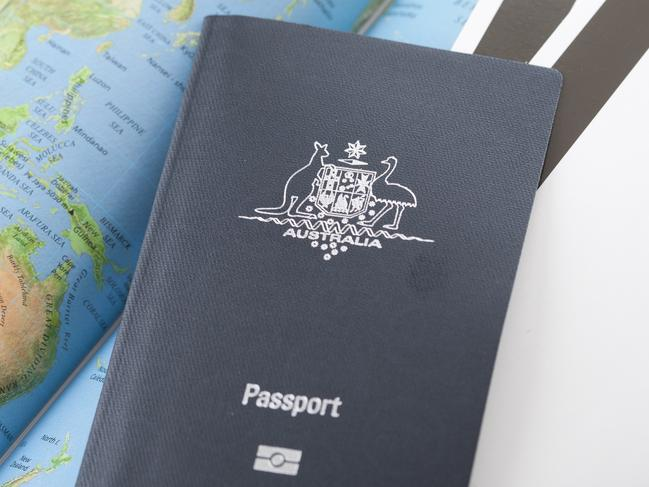 """Lismore, NSW, Australia - February 28, 2012: New Australian electronic e-passport ready to travel with boarding passes and a map of the world"""